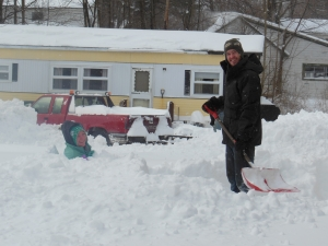 Jeff shoveling - Jillian sitting in the snow (neighbors).