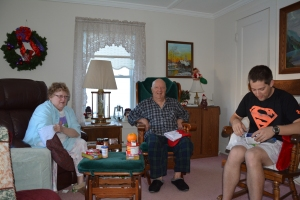 Mom, Dad, Joe opening their stockings